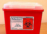 Sharps box with biohazard symbol