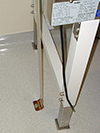 Biological safety cabinet bolted to the floor with a metal brace