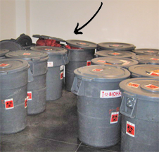 Over filled and uncovered BIOHAZARD containers are a regulatory violoation.