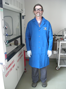 Researcher wearing a flame resistant lab coat